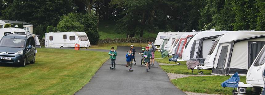 Boys riding scooters on Alton Club Site
