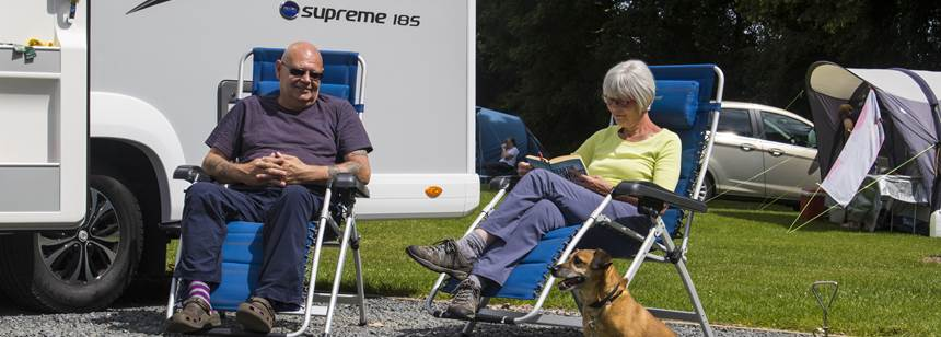 Couple relaxing on Blackmore Club Site
