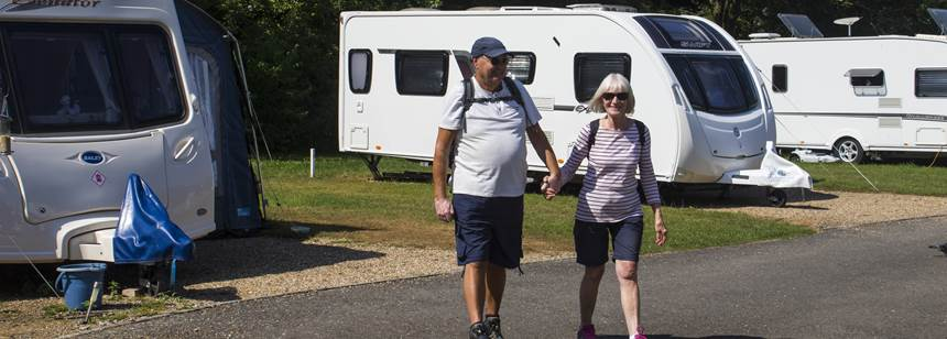 Couple walking through the Canterbury campsite.