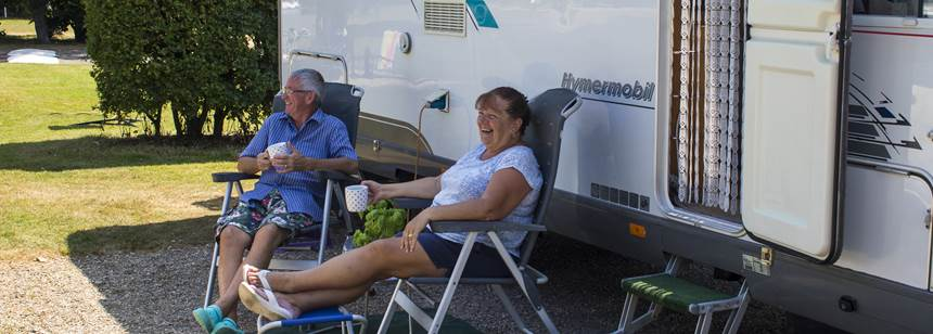 Couple relaxing on Canterbury Camping and Caravanning Club Site