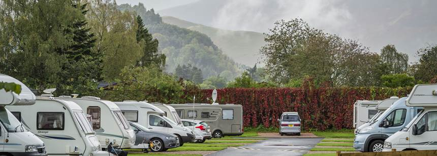 Motorhomes and caravans pitched on Derwentwater campsite