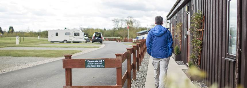 Man walking to facilities at Conkers Club Site
