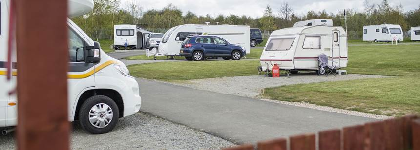Caravans and motorhomes pitched up on Conkers campsite