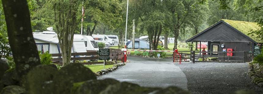 A Couple Relaxing and Enjoying the Peaceful Atmosphere at Haltwhistle Camp Site, Northumberland