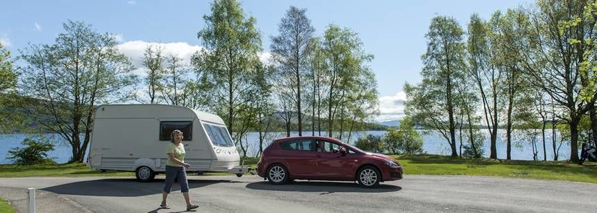 A Couple Relaxing by Their Grass Pitch by the Banks of Loch Lomand at the Luss Camp Site, Glasgow
