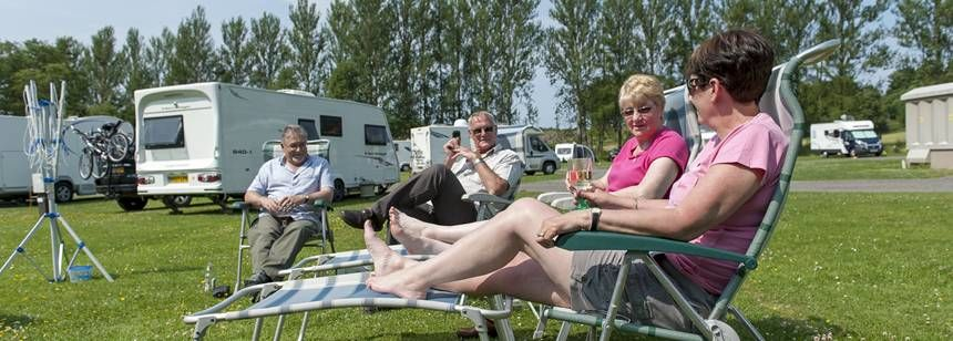 Campers relaxing on Scone campsite