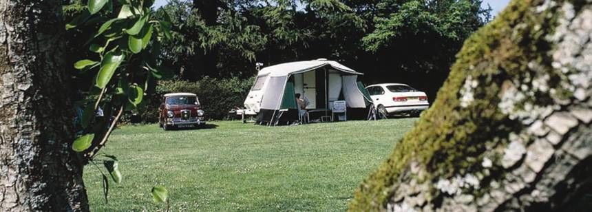 A Caravan Pitched in the Shade of Trees at the Slindon Campsite, Sussex