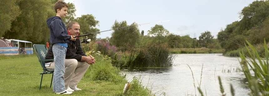Fishing With the Family on  the Banks of the Great Ouse at the St Neots Campsite, Cambridgeshire