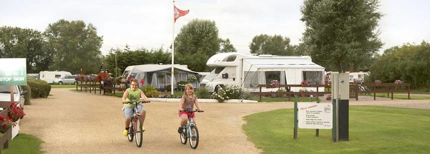 Kids Cycling Through the Peaceful Surroundings of the St Neots Campsite, Cambridgeshire