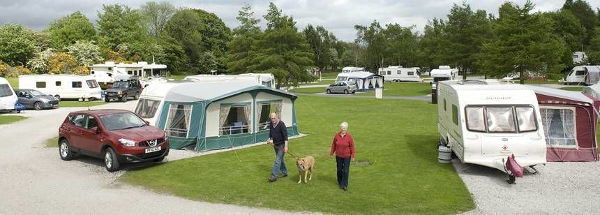Caravans and awnings pitched on Windermere campsites.