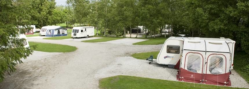 Caravans on hardstanding pitches at Windermere campsite.