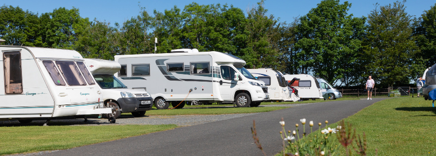 A Couple Relaxing and Enjoying the Peaceful Surroundings of the Tavistock Camp Site, Devon