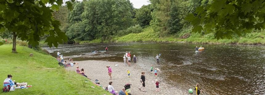 Relaxing and `Enjoying Water Sports in the River Adjacent to Clitheroe Camp Site, Lancashire