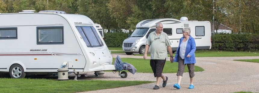 Couple walking through Kingsbury campsite