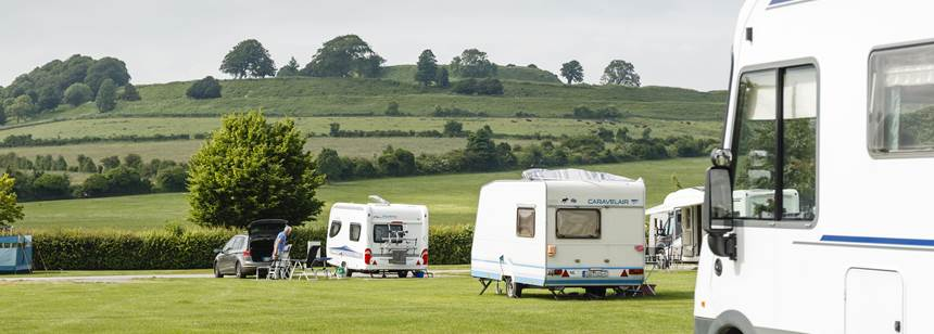 A Couple Enjoying a Stroll Through the Picturesque Setting of the Salisbury Campsite, Wiltshire