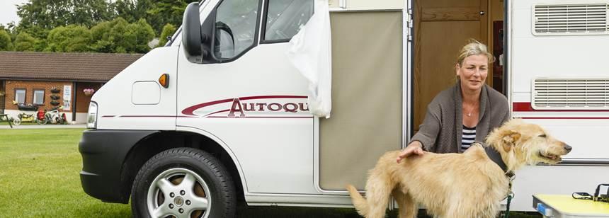 Lady sitting with dog on Salisbury campsite