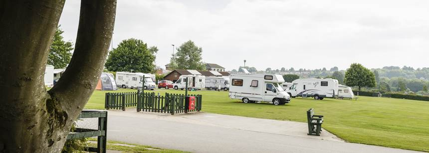 Motorhomes pitched up on grass at Salisbury campsite