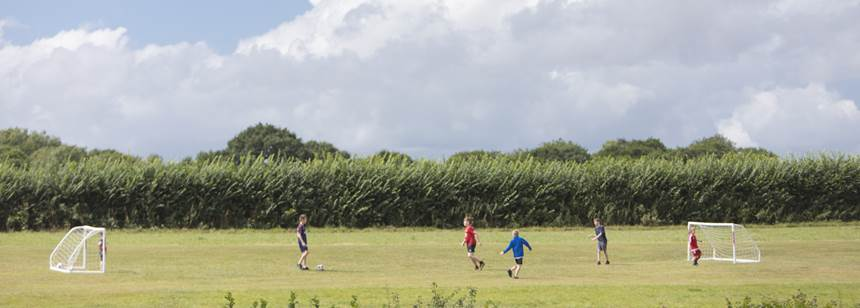 Kids playing football on Umberleigh Campsite