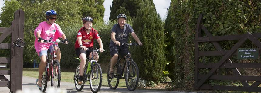 Family cycling on Umberleigh Campsite