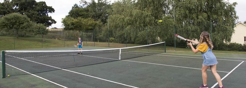 Kids playing tennis on Umberleigh Campsite
