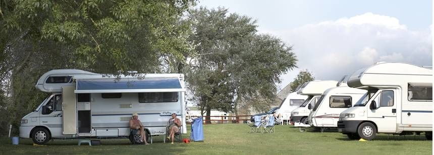 A Couple Relaxing in the Shade of the Wooded Surrounds of the Weston Super Mare Camp Site, Somerset