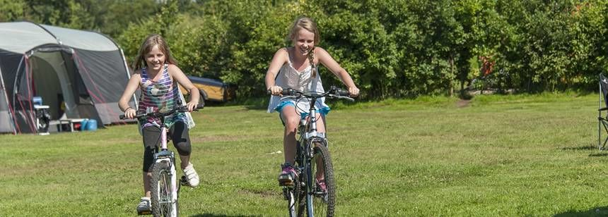 Kids Cycling and Enjoying Their Time at Gullivers Milton Keynes Camp Site, Bucks