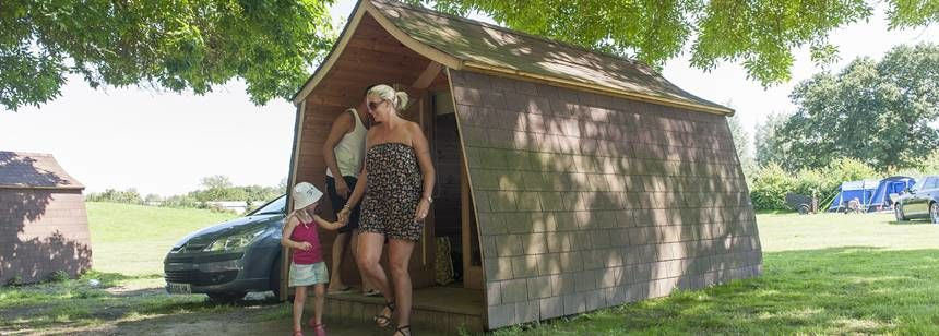 A Family Enjoying one of the Luxury Camping Pods at Gullivers Milton Keynes Camp Site, Bucks