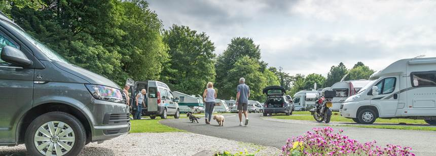A Couple Relaxing Beside Their Motor Home in Boroughbridge Camp Site