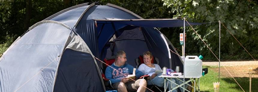 Family relaxing at Thetford Forest Campsite, Norfolk