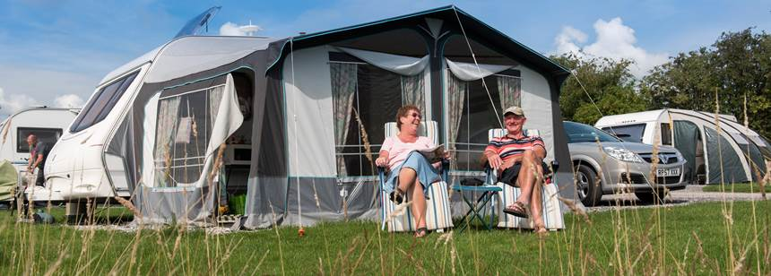 Family relaxing on Ashbourne campsite.