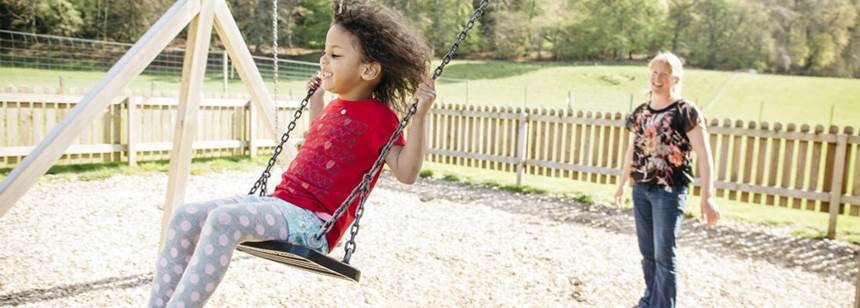 Fun on the swings at Loch Ness Club Site